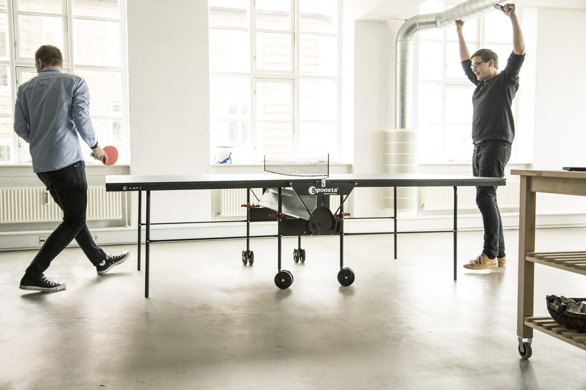 EasyPractice team members playing table tennis